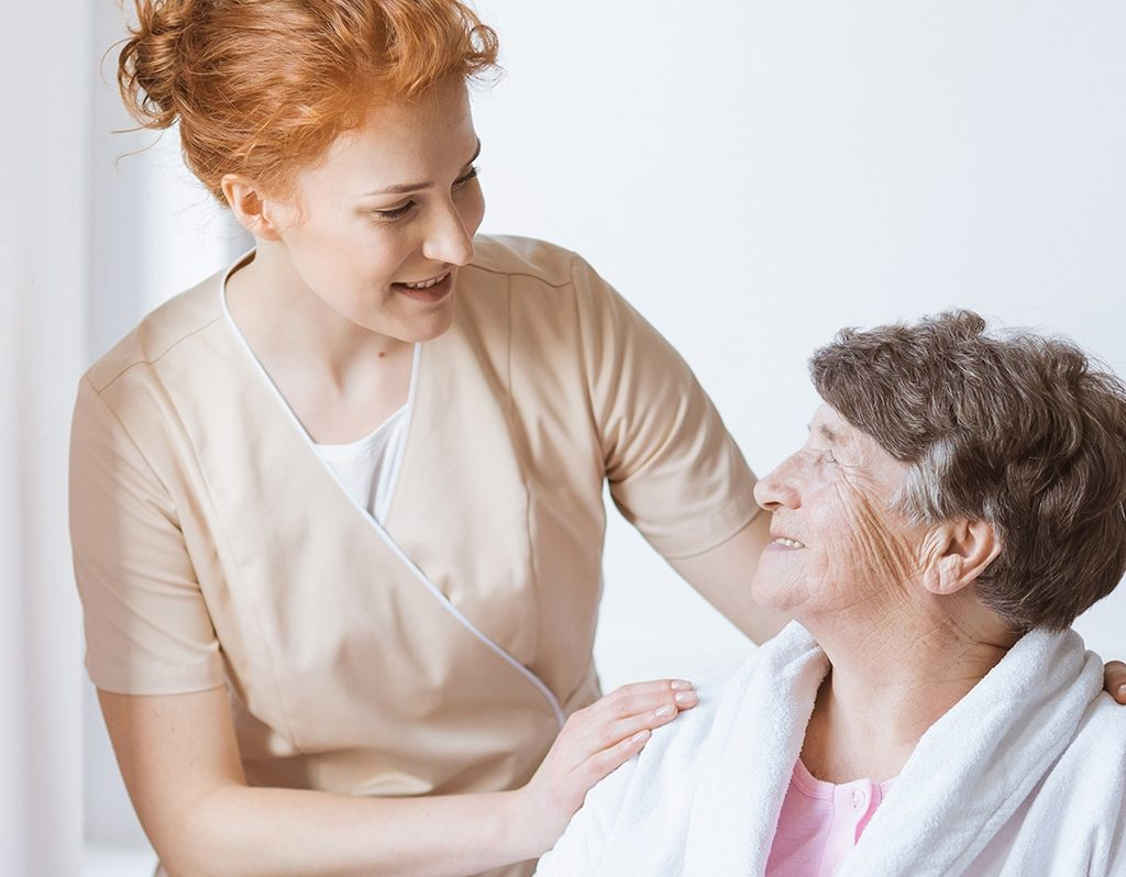 Nurse with care home resident