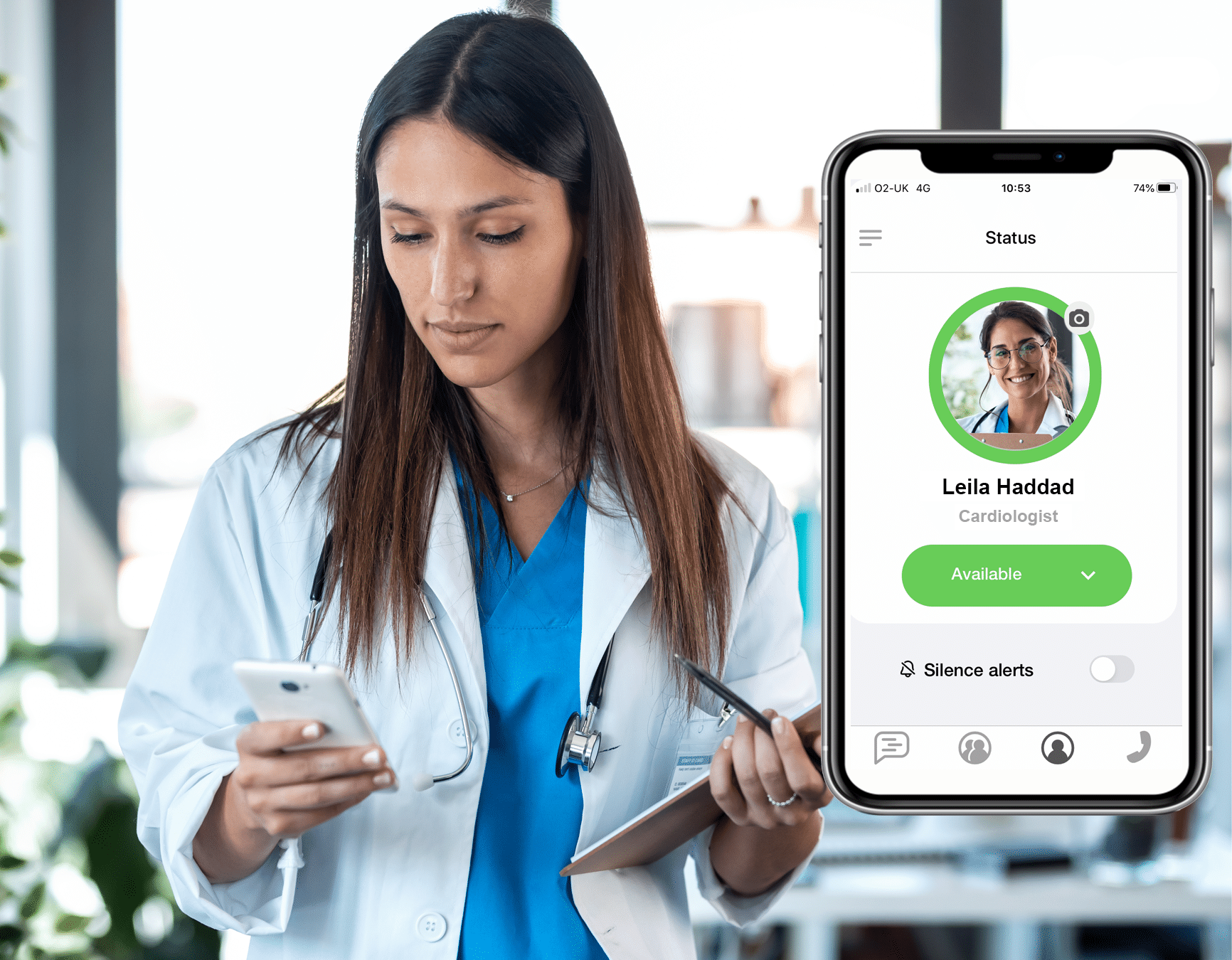 Doctor using a smartphone running the Multitone messaging app, and showing the status screen on the phone.